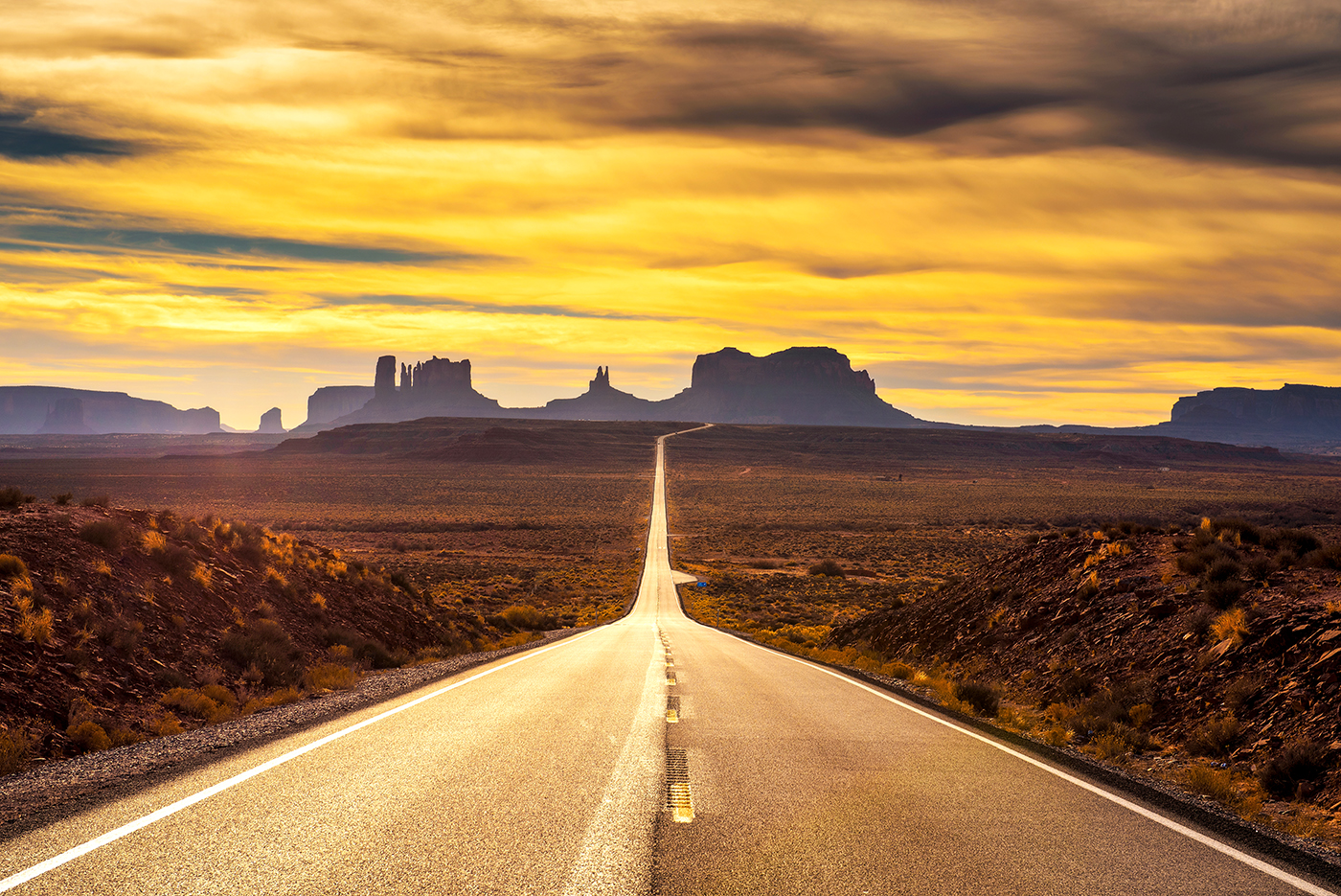 Desert Road Leading To Monument Valley